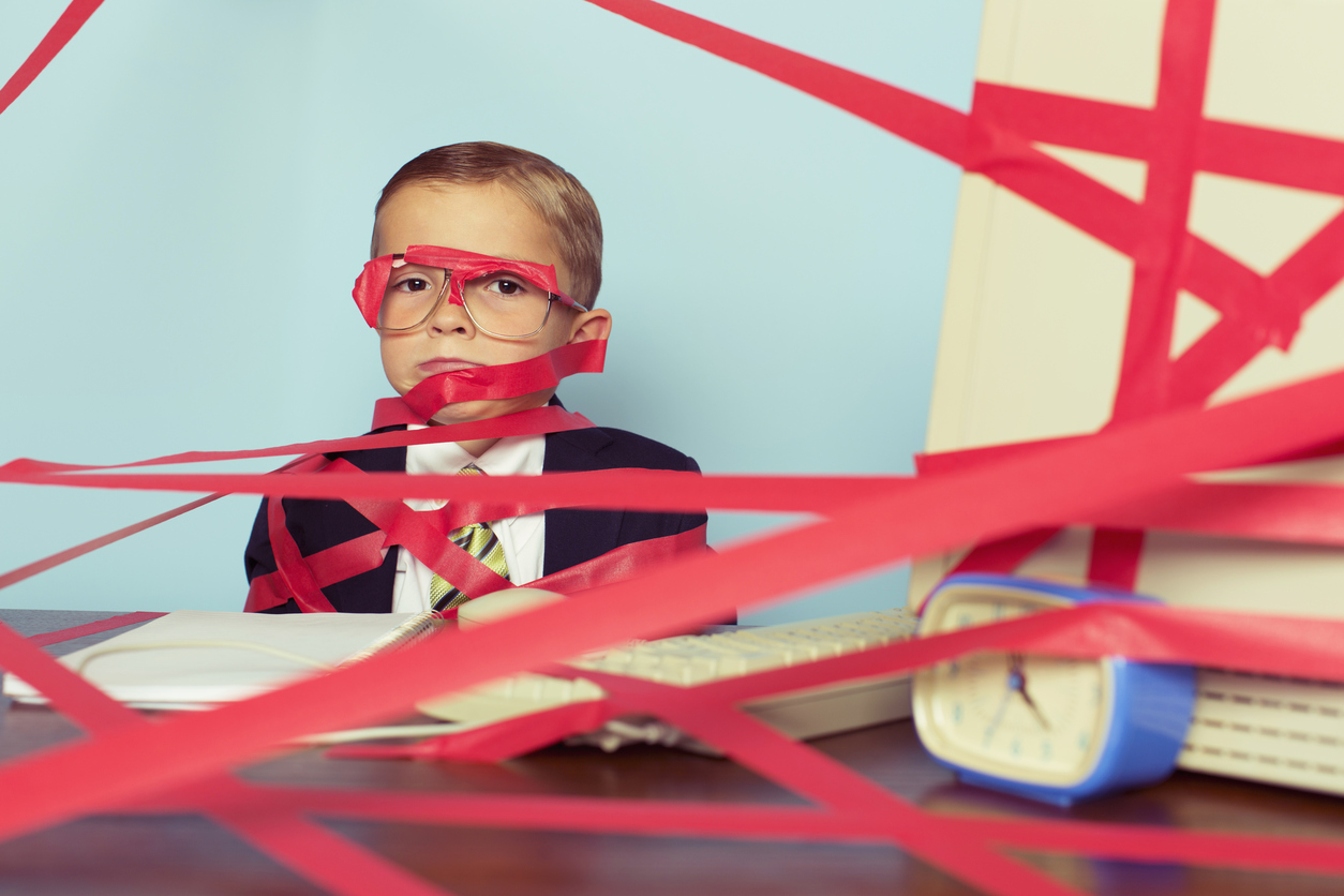 Boy in Suit Tangled in Red Tape
